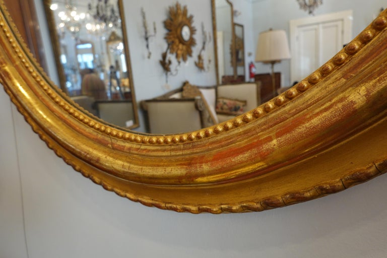 French Louis XVI Style Giltwood Mirror with Large Carved Bow Cartouche For Sale 3