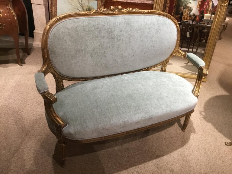 French love seat in a sea foam teal hue new upholstery. The back upholstered