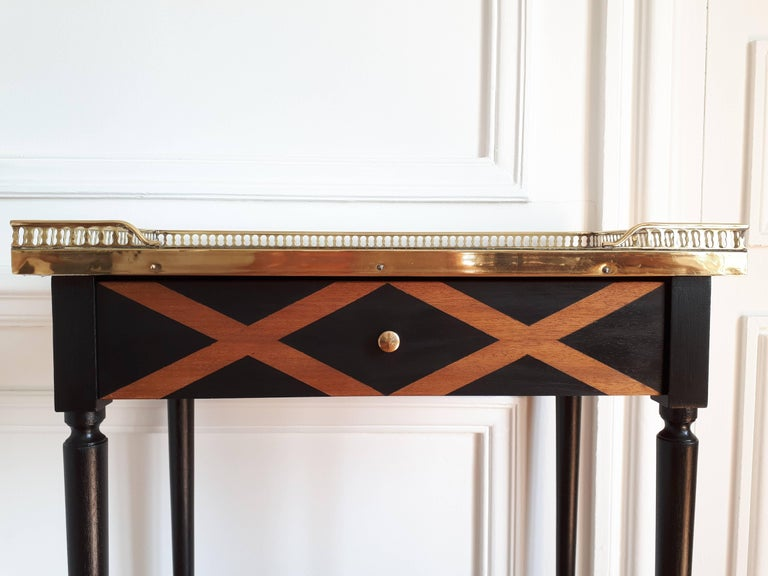 Antique French Louis XVI style nightstand or side table topped with a Carrara marble, four legs finished with golden bronze clogs. Brass gallery and one front drawer.