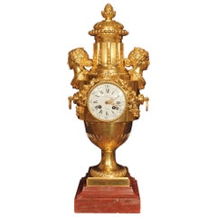French Louis XVI Style Mid-19th Century Ormolu and Rouge Griotte Marble Clock