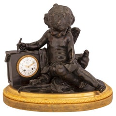 French Louis XVI Style Ormolu and Patinated Bronze Clock, Signed by Deniere