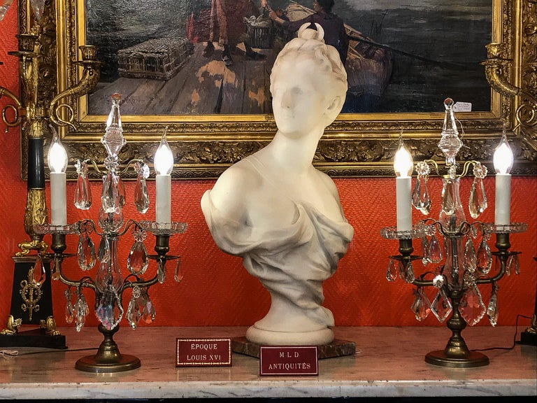 French Louis XVI Style, pair of gilt bronze and cut-crystal girandole lamps  Elegant and decorative pair of gilt bronze girandole candelabra lamps.  Fine quality cut crystal decoration with white crystal faceted plaques and white cut-crystal