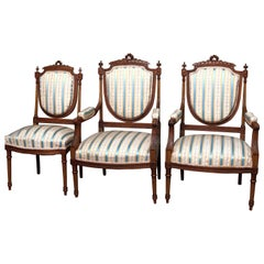 French Louis XVI Style Parcel-Gilt Carved Walnut Parlor Set, 19th Century