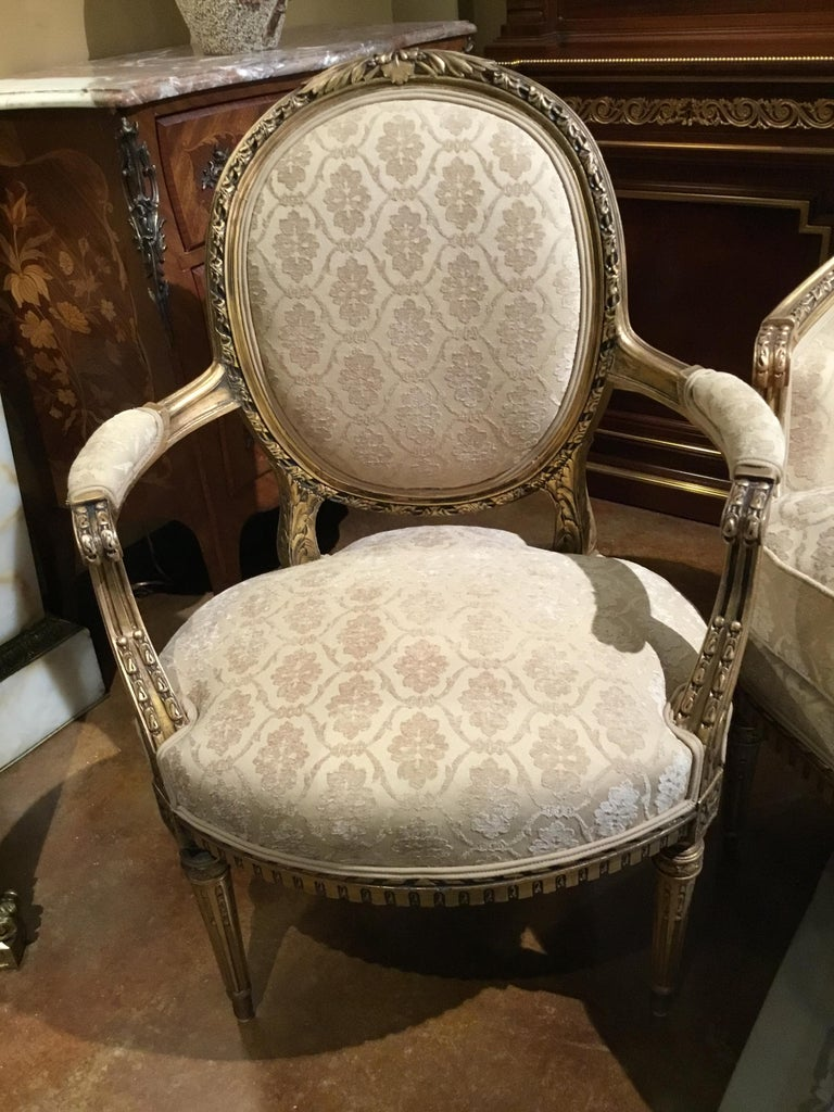 French Louis XVI Style Settee and Two Armchairs, Giltwood, Cream Hue In Good Condition For Sale In Houston, TX