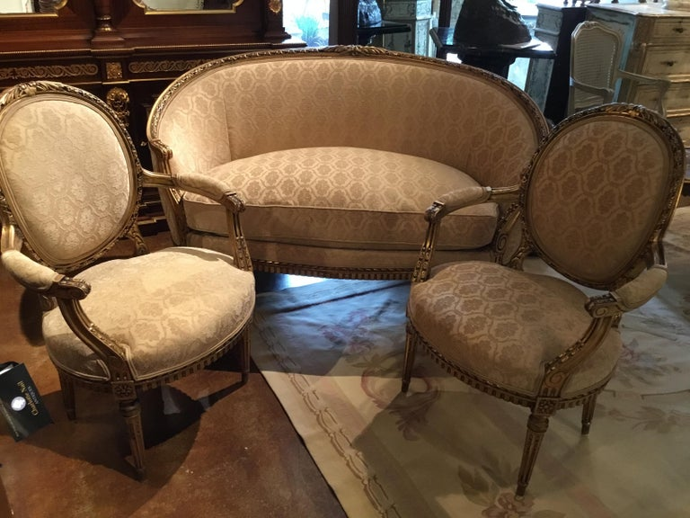 19th Century French Louis XVI Style Settee and Two Armchairs, Giltwood, Cream Hue For Sale