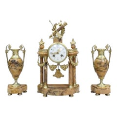 French Louis XVI Style Sienna Marble and Bronze Gilt Clock Set