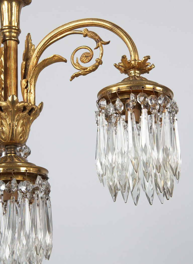 French Louis XVI Style Solid Brass and Crystals Four-Light Chandelier, 1870s For Sale 6