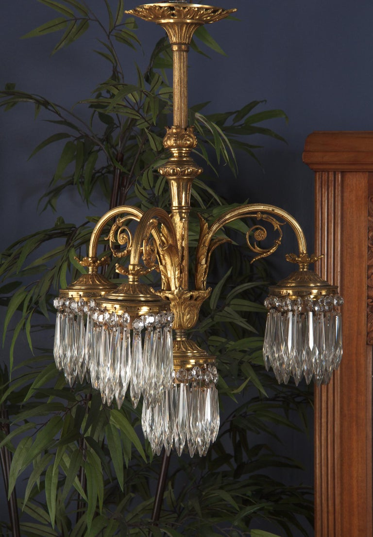 French Louis XVI Style Solid Brass and Crystals Four-Light Chandelier, 1870s For Sale 7