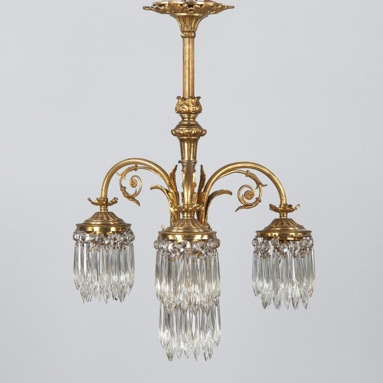 French Louis XVI Style Solid Brass and Crystals Four-Light Chandelier, 1870s For Sale 8