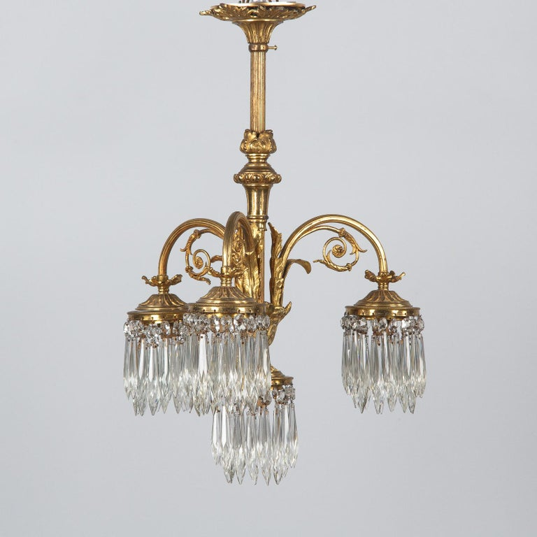 French Louis XVI Style Solid Brass and Crystals Four-Light Chandelier, 1870s For Sale 10