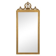 French Louis XVI Style Tall Gilded Mirror with Swag & Wreath Crest