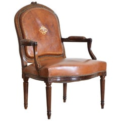 French Louis XVI Style Walnut and Leather Upholstered Fauteuil, 19th Century