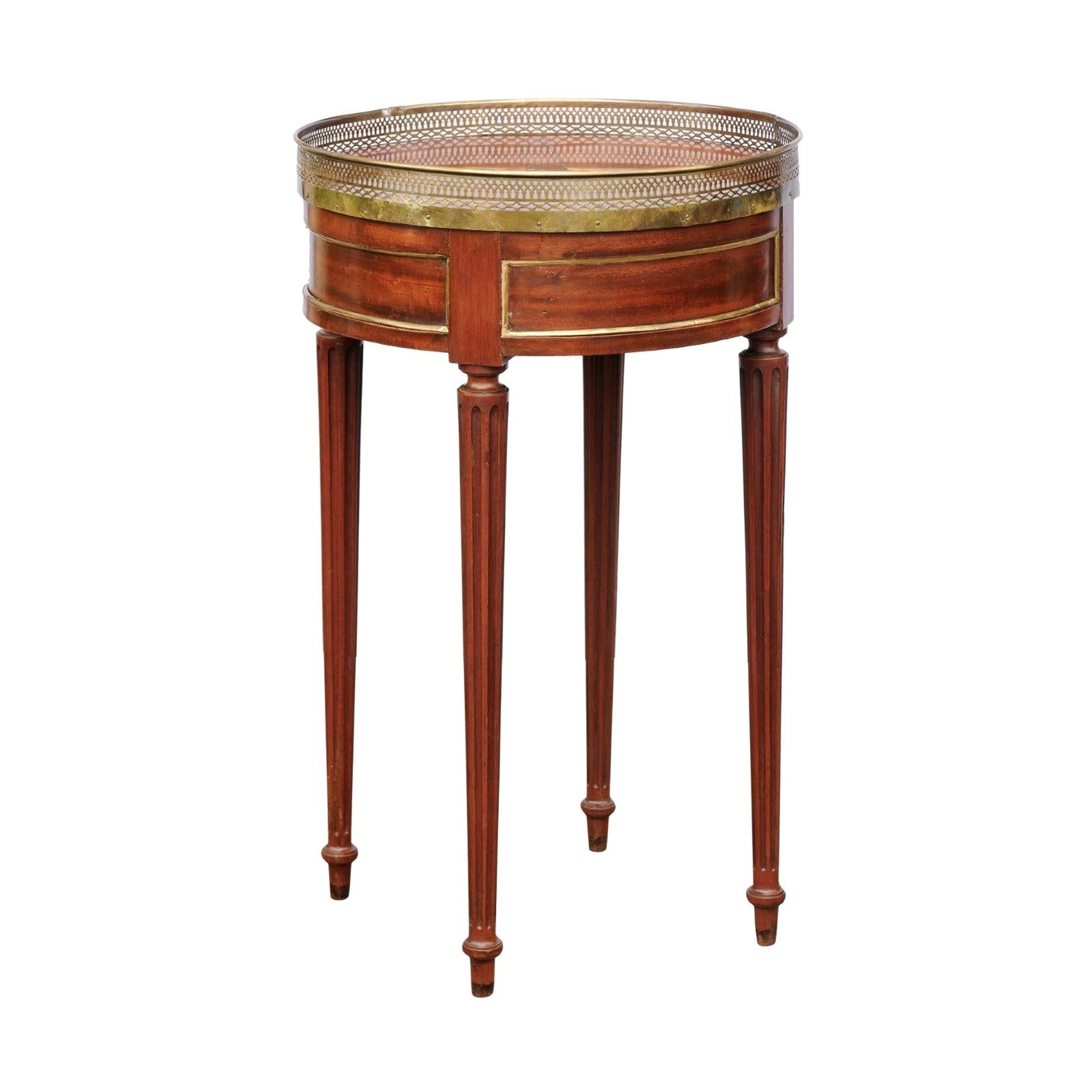 French Louis XVI Style Walnut Guéridon Table with Brass Gallery and Fluted Legs