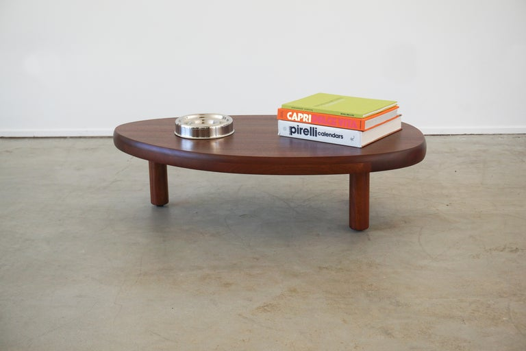 Gorgeous coffee table in the style of 1950's French design with 3 legs and freeform organic shape. Newly produced by Orange in mahogany wood Incredible gain and wood joinery.