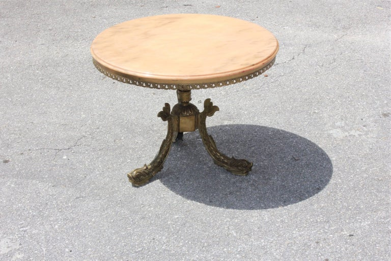 Beautiful French Maison Jansen ''fish leg'' round coffee or cocktail bronze table with onyx top, circa 1940s, very nice bronze detail with three fish leg base ,the onyx are in beautiful color beige, the onyx and the bronze table are in perfect