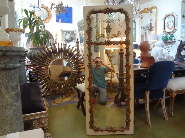 Unusual French Maison Jansen style chinoiserie églomisé mirror, circa 1920. This vertical French Trumeau style mirror is painted a cream color with gilt accents. Perfect hall mirror.