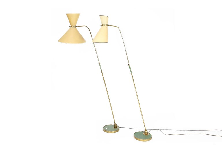 A pair of French Maison Lunel articulating floor lamps in brass. 