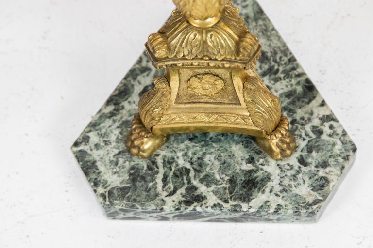 French marble-top table, with ormolu stem on a Verde marble base.