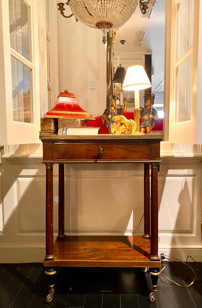 French Marble-Top Writing Table on Casters, Pull-Out Drawer, Gilt Tooled-Leather Writing Surface above the drawer, lower storage shelf. Versatile in its design and size, beautiful warm patina colour with green leather writing surface detailed in