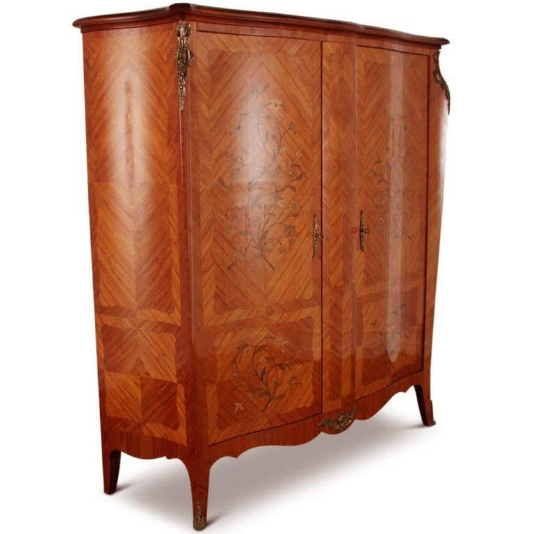 A French kingwood-and-marquetry two-door bombe armoire, with ormolu mounts and three interior adjustable shelves, one with fitted small drawers.