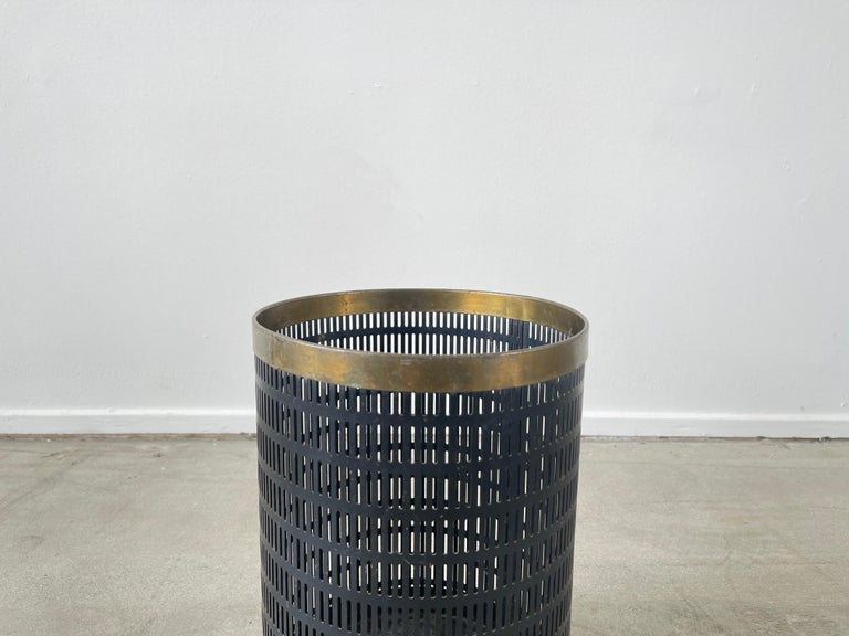 Great trash bin in the style of Mathieu Matégot Perforated metal with brass rimed top.