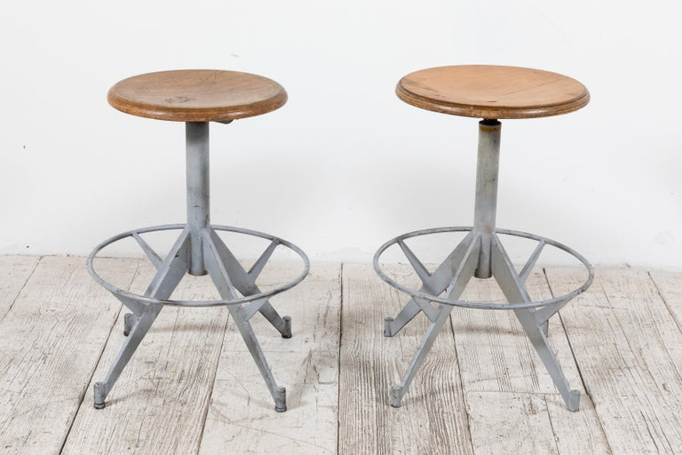 French metal swivel stool with wood top.