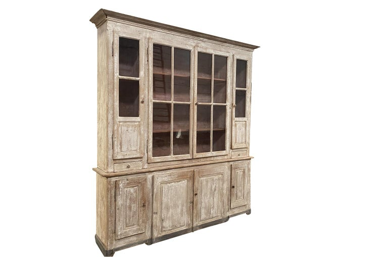A very handsome mid-19th century buffet deux corps from the Provence region of France. Soundly constructed with 8 doors, 2 drawers and interior shelves. A wonderful cabinet for display and storage. Terrific patina.
