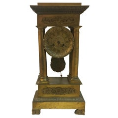 French Mid-19th Century Empire Portico Gilded Bronze Clock