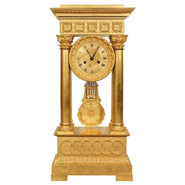 French Mid-19th Century Empire Style Ormolu Portico Clock For Sale
