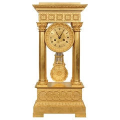 French Mid 19th Century Empire Style Ormolu Portico Clock