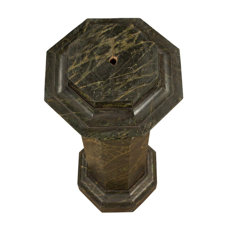 A handsome and decorative French mid-19th century faux painted marble octagon shaped pedestal. The pedestal is raised by a thick base below a mottled design. Above is the column with a top band below an impressive mottled and protruding top. All