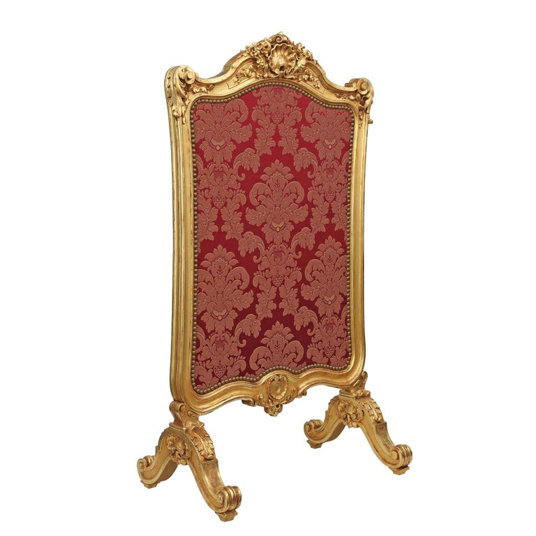 An exceptional French mid-19th century Louis XV style giltwood screen. The screen has wonderful carvings of acanthus leaves and shells, including a most impressive top center shell surrounded by richly carved flowers. The whole is raised on four