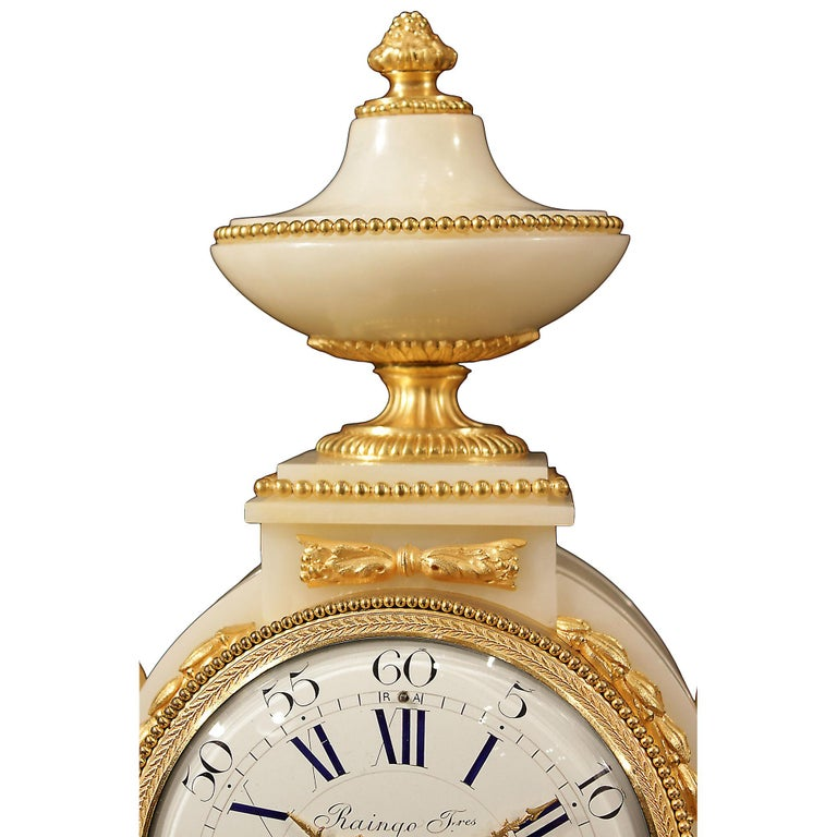 A striking French mid-19th century Louis XVI style onyx and ormolu clock signed 'Raingo Fréres, Paris'. Raised by rectangular and circular reeded ormolu feet below the impressive rectangular base with rounded corners decorated with ormolu rosettes