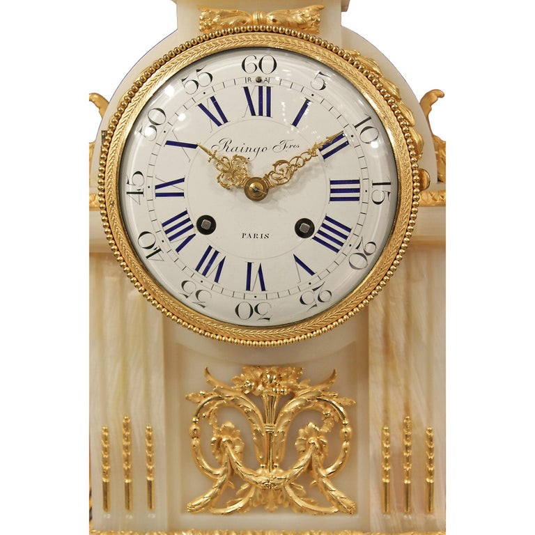 French Mid-19th Century Louis XVI Style Onyx and Ormolu Clock In Excellent Condition For Sale In West Palm Beach, FL