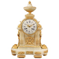 French Mid-19th Century Louis XVI Style Onyx and Ormolu Clock