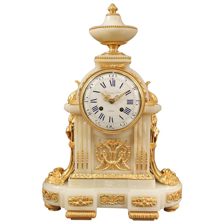 French Mid-19th Century Louis XVI Style Onyx and Ormolu Clock For Sale