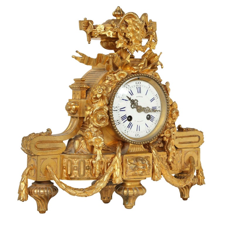 A fine French mid-19th century Louis XVI style ormolu clock, stamped in Japy Freres Médaille d'Or, 1855. The clock is raised on topie feet below the curved ormolu base decorated with draped laurel garlands. The enamel dial above is centered amidst