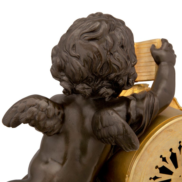 Mid-19th Century Louis XVI Style Patinated Bronze, Ormolu and Marble Clock For Sale 4