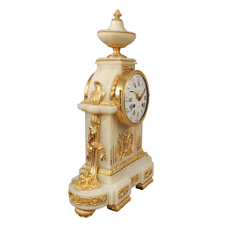A striking French mid 19th century Louis XVI st. onyx and ormolu clock signed