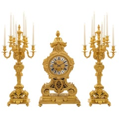 French Mid-19th Century Ormolu Three-Piece Garniture Clock Set