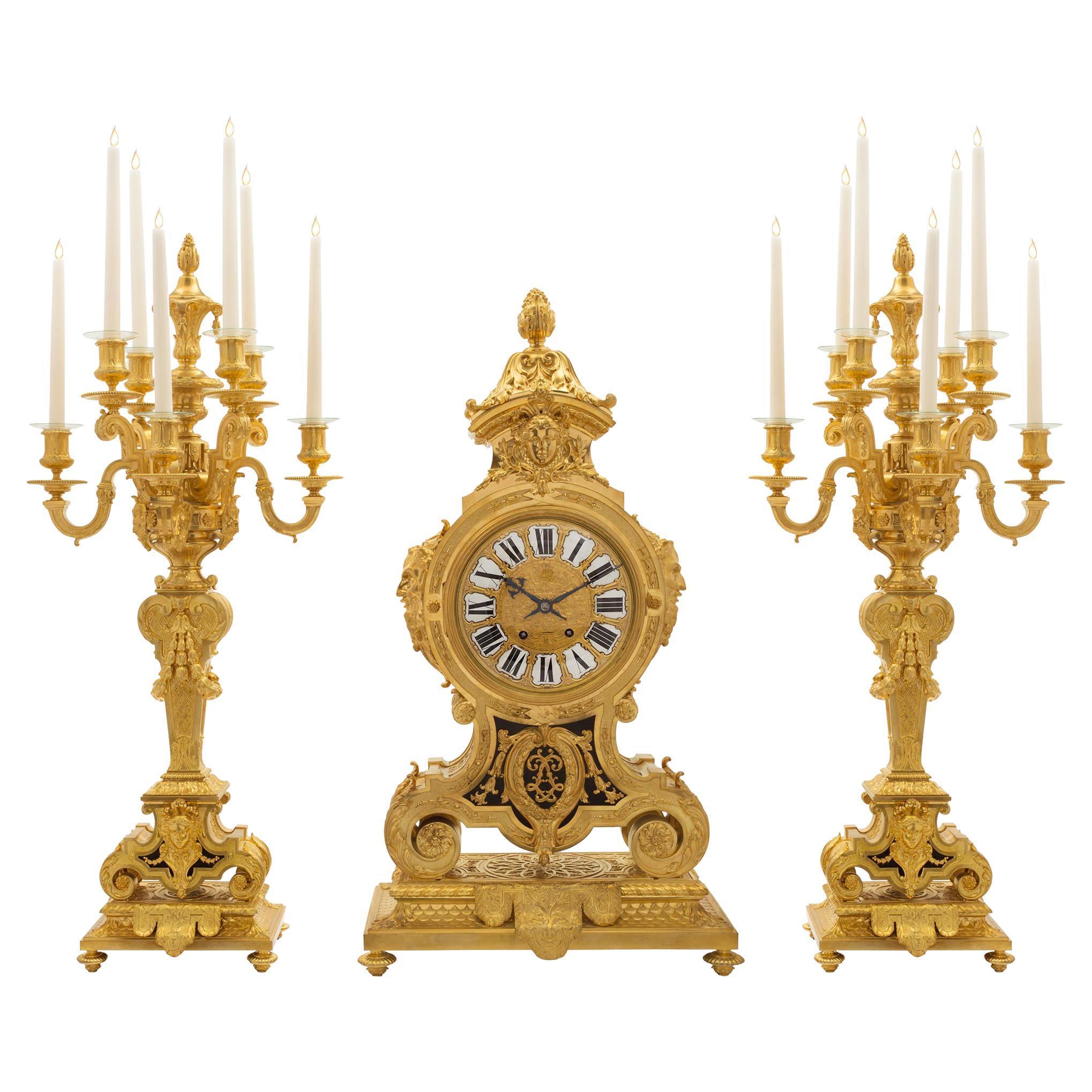 French Mid-19th Century Ormolu Three-Piece Garniture Clock Set