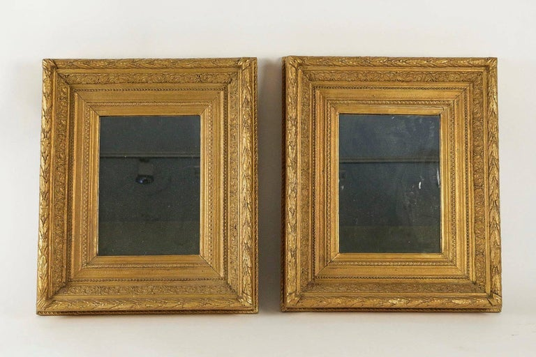 A very decorative pair of mercury and hand carved giltwood mirror.  French mid-19th century Napoleon III period, circa 1860  Dimensions with frame: W 18.89 in. H 22.44 in.  In fine condition.