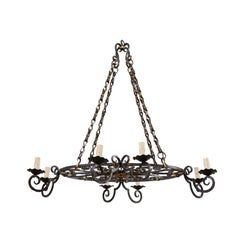 French Mid-20th Century Round Forged Black and Gold Scrolled Iron Chandelier