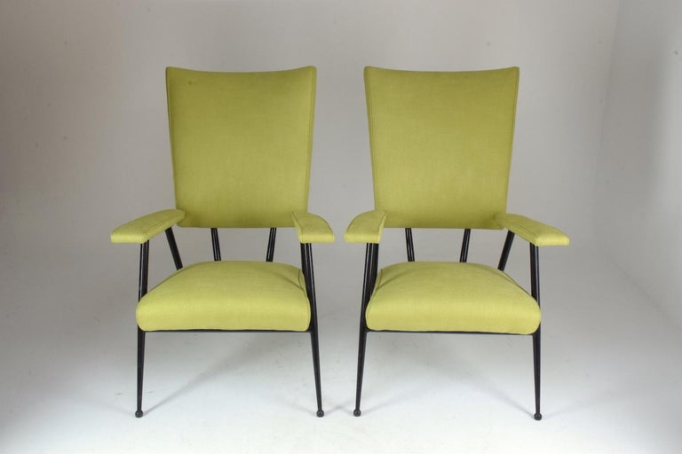Four French midcentury lounge chairs in a tubular black re-lacquered steel frame and light green upholstery. France, circa 1950s.   All our pieces are fully restored at our atelier and we only offer items that will last another lifetime. There