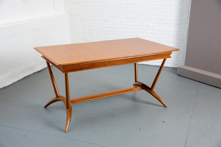 Beautiful 1940s MidCcentury French dining table with 1 leaf. Splayed leg base. Marked