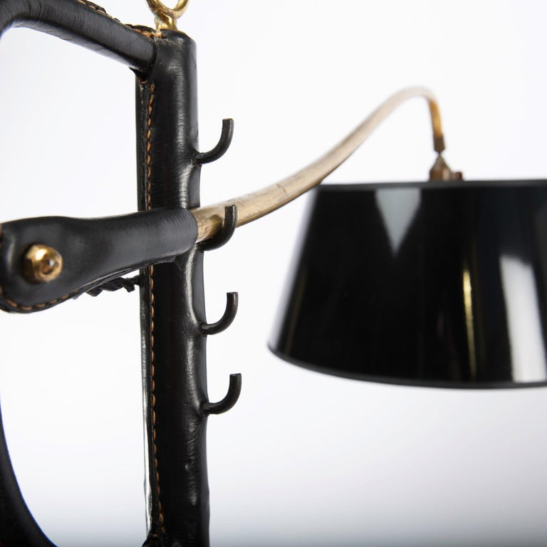 Scarce floor lamp designed by Jacques Adnet, circa 1955. In French the model is called