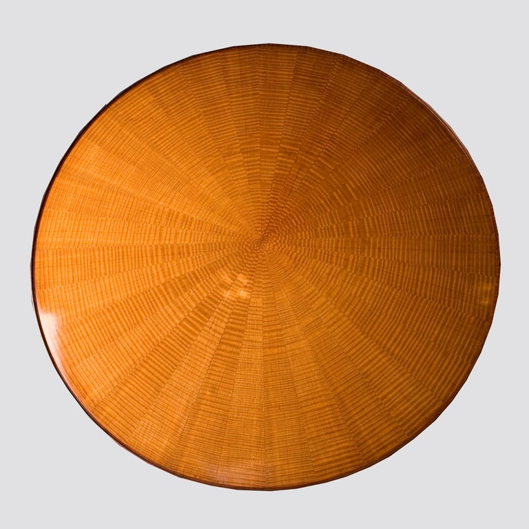Coffee table in fiddled sycamore with sunburst designed veneer to the top and brass feet.