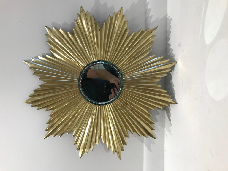French Mid-Century Modern gilt bronze sunburst mirror.