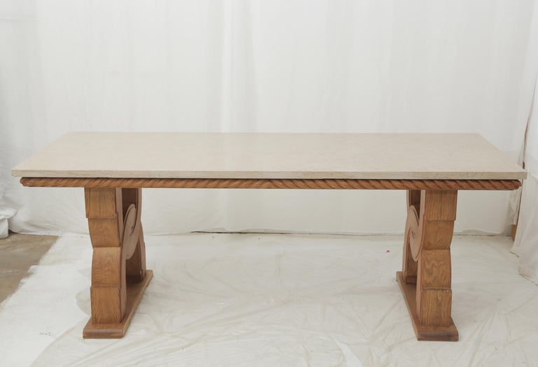Hand carved oak base in the style of French designer Jean-Charles Moreux with a carved rope all around the upper part and underneath the Comblanchien stone top. A rigorous and very architectural design piece which could fit as a console table or a