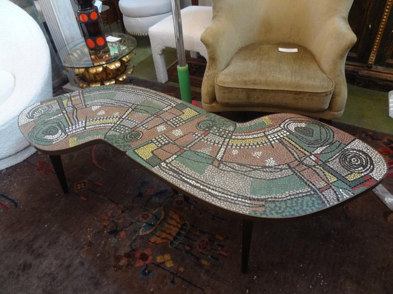 Rare stunning French Mid-Century Modern two part mosaic tile topped curved table. These fantastic French curved tables can be used together to create a large cocktail table or separated and used as a pair of curved side tables. This pair of tables